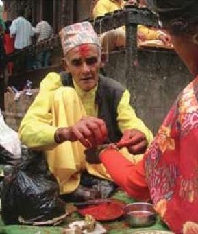 Janai Purnima: a priest offering sacred thread