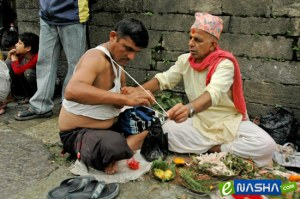 Janai Purnima: a priest offering sacred thread