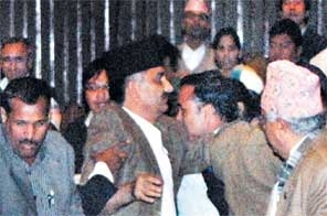 November 2010: Maoist lawmakers roughing up Finance Minister Surendra Pandey as the latter prepares to present the budget for 2010/11 fiscal in the parliament.